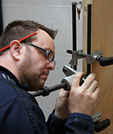 locksmith working on door