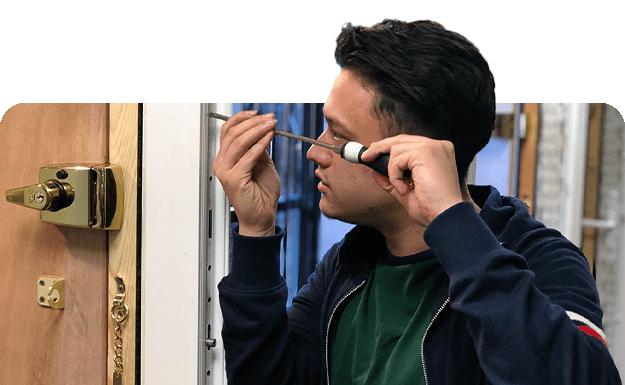 keytek locksmith trainee working on door