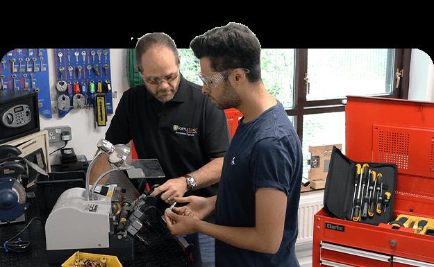 keytek locksmiths training on the key cutting machine