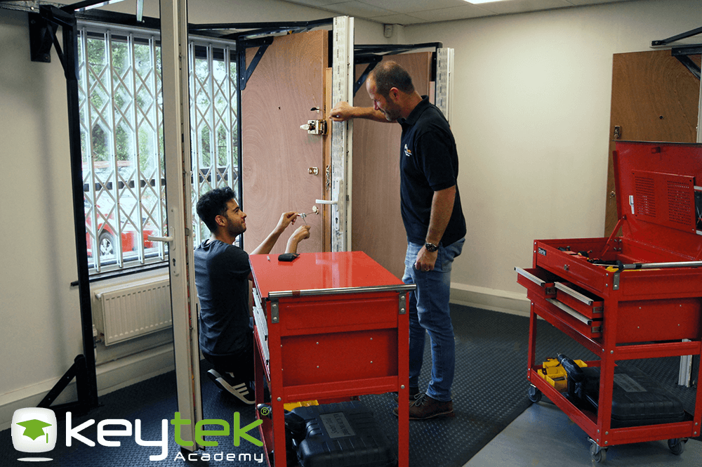 locksmith trainer teaching how to open locks at keytek