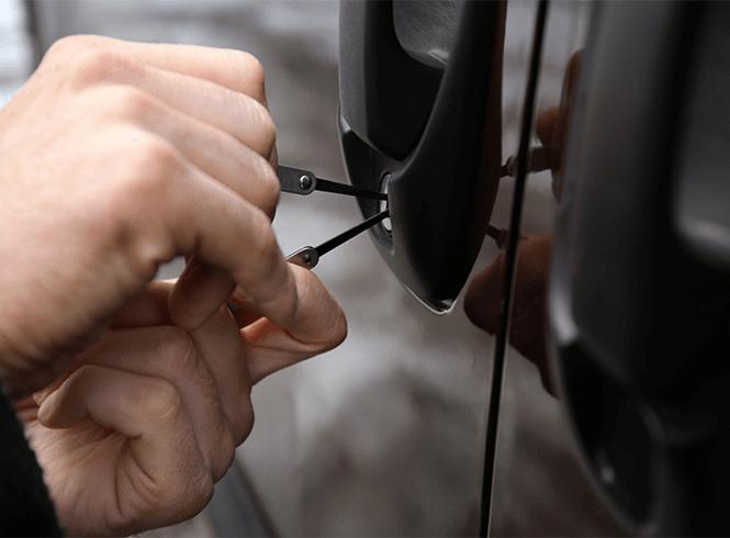 Locksmith picking a car lock